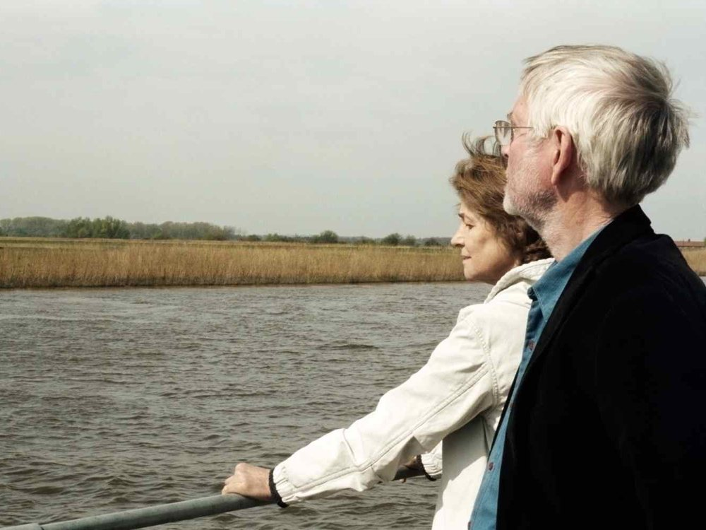 45-years-2014-021-kate-and-geoff-looking-out-over-broads_1000x750